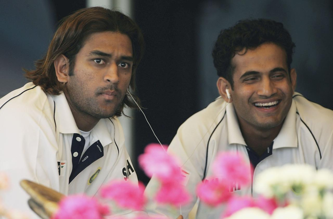 CHANDIGARH, INDIA - MARCH 10:  Mahendra Dhoni and Irfan Pathan of India listen to music during day two of the Second Test Match between India and England at the Punjab Cricket Association Ground on March 10, 2006 in Mohali, Chandigarh, India.  (Photo by Tom Shaw/Getty Images)