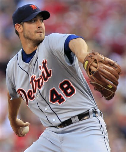 Detroit Tigers starting pitcher Rick Porcello throws to a Cincinnati Reds batter in the first inning of a baseball game, Friday, June 8, 2012, in Cincinnati. (AP Photo/Al Behrman)