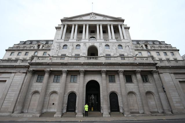 A lone security guard stands outside the Bank of England. Photo: Getty