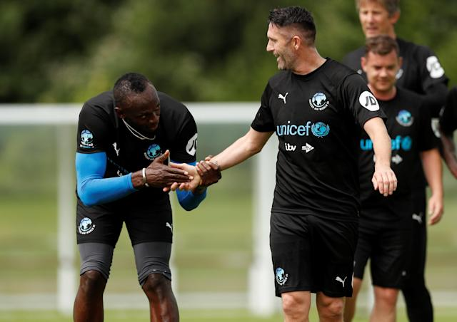 Soccer Football - England & Soccer Aid World XI Training - Motspur Park, London, Britain - June 8, 2018 Soccer Aid World XI's Usain Bolt and Robbie Keane during training Action Images via Reuters/Andrew Boyers