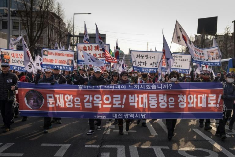 Protestors demonstrate against the visit of North Korean General Kim Yong Chol who will attend the Winter Olympics closing ceremony Sunday