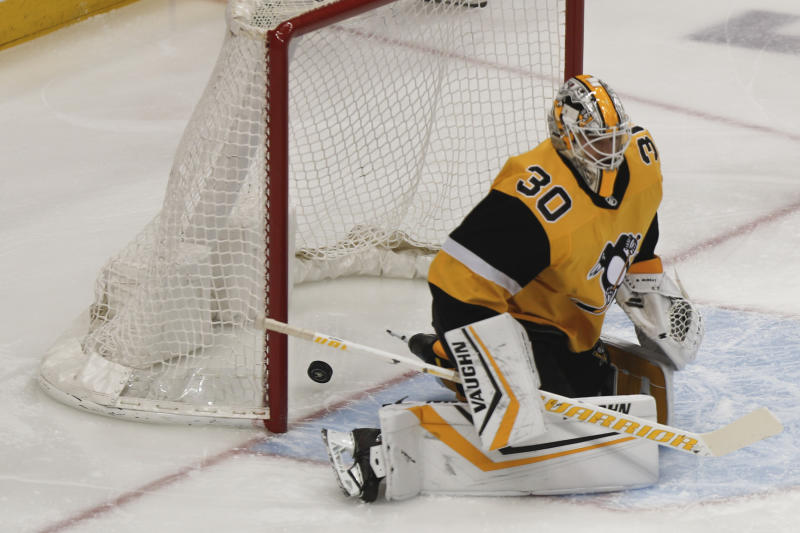 A shot by Washington Capitals' Nic Dowd gets past Pittsburgh Penguins goaltender Matt Murray for a goal during the first period of an NHL hockey game, Saturday, March 7, 2020, in Pittsburgh. (AP Photo/Keith Srakocic)