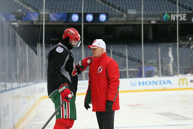NEW YORK, NY - JANUARY 25: (EDITORIAL USE ONLY) Jaromir Jagr #68 and President and GM Lou Lamoriello of the New Jersey Devils chat on the ice the day before their outdoor game against the New York Rangers at Yankee Stadium on January 25, 2014 in the Bronx borough of New York City. (Photo by Bruce Bennett/Getty Images)