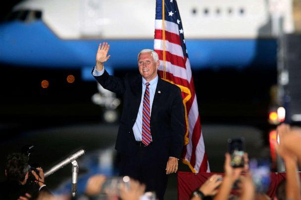 PHOTO: Vice President Mike Pence waves to supporters, Oct. 24, 2020 in Tallahassee, Fla. (Steve Cannon/AP)