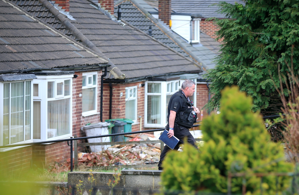 <em>Police investigate a house following the arrests (SWNS)</em>