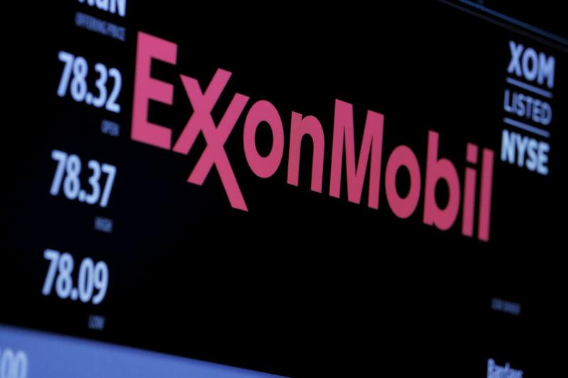 FILE PHOTO: The logo of Exxon Mobil Corporation is shown on a monitor above the floor of the New York Stock Exchange in New York