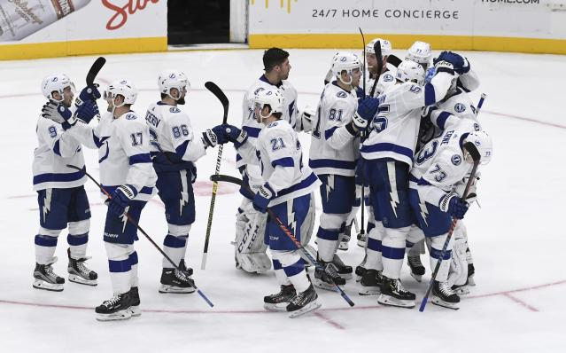Tampa Bay Lightning players celebrate a 1-0 shootout win against the New York Islanders in an NHL hockey game, Friday, Feb. 1, 2019, in Uniondale, N.Y. (AP Photo/Kathleen Malone-Van Dyke)