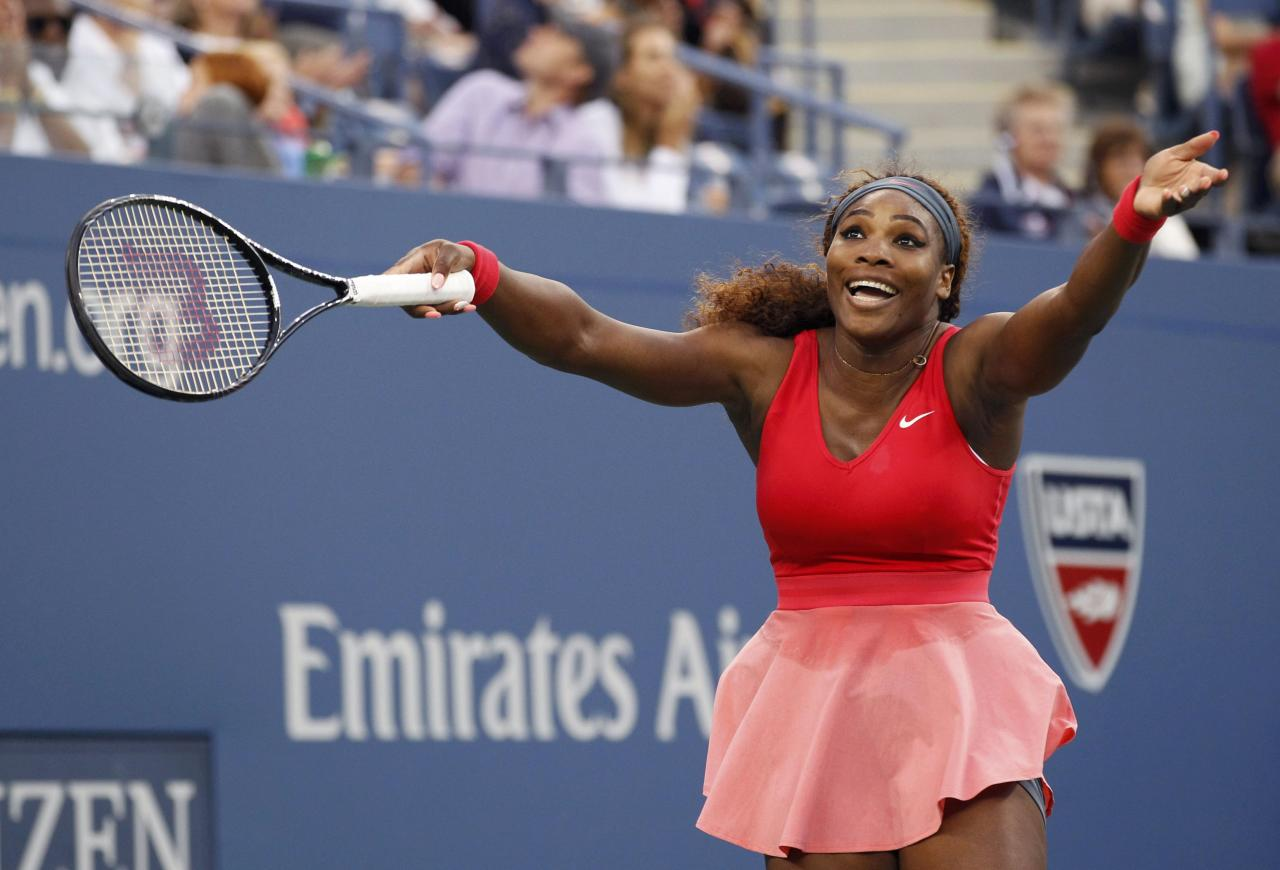 Serena Williams of the U.S. reacts to the wind while playing Victoria Azarenka of Belarus during their women's singles final match at the U.S. Open tennis championships in New York September 8, 2013. REUTERS/Adam Hunger (UNITED STATES - Tags: SPORT TENNIS)