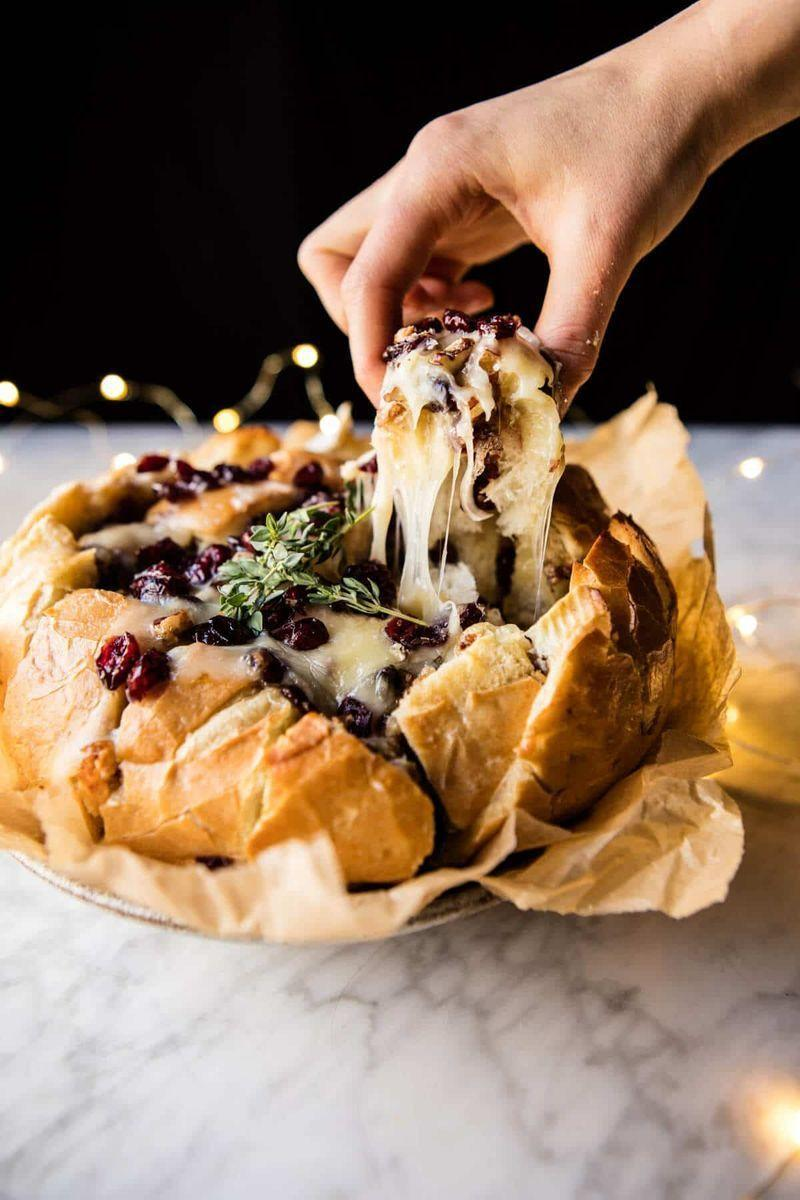 """<p>Hold off hunger before the main event with this melty Thanksgiving appetizer.</p><p><strong>Get the recipe at <a href=""""https://www.halfbakedharvest.com/cranberry-brie-pull-apart-bread/"""" rel=""""nofollow noopener"""" target=""""_blank"""" data-ylk=""""slk:Half Baked Harvest"""" class=""""link rapid-noclick-resp"""">Half Baked Harvest</a>.</strong> </p>"""