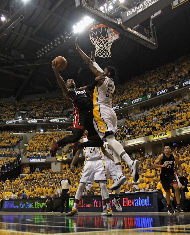INDIANAPOLIS, IN - MAY 24: Dwyane Wade #3 of the Miami Heat goes up for a shot against Roy Hibbert #55 of the Indiana Pacers in Game Six of the Eastern Conference Semifinals in the 2012 NBA Playoffs at Bankers Life Fieldhouse on May 24, 2012 in Indianapolis, Indiana. NOTE TO USER: User expressly acknowledges and agrees that, by downloading and/or using this photograph, User is consenting to the terms and conditions of the Getty Images License Agreement. (Photo by Jonathan Daniel/Getty Images)