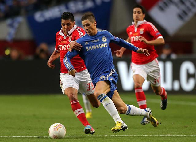 Benfica's Enzo Perez (left) and Chelsea's Fernando Torres battle for the ball