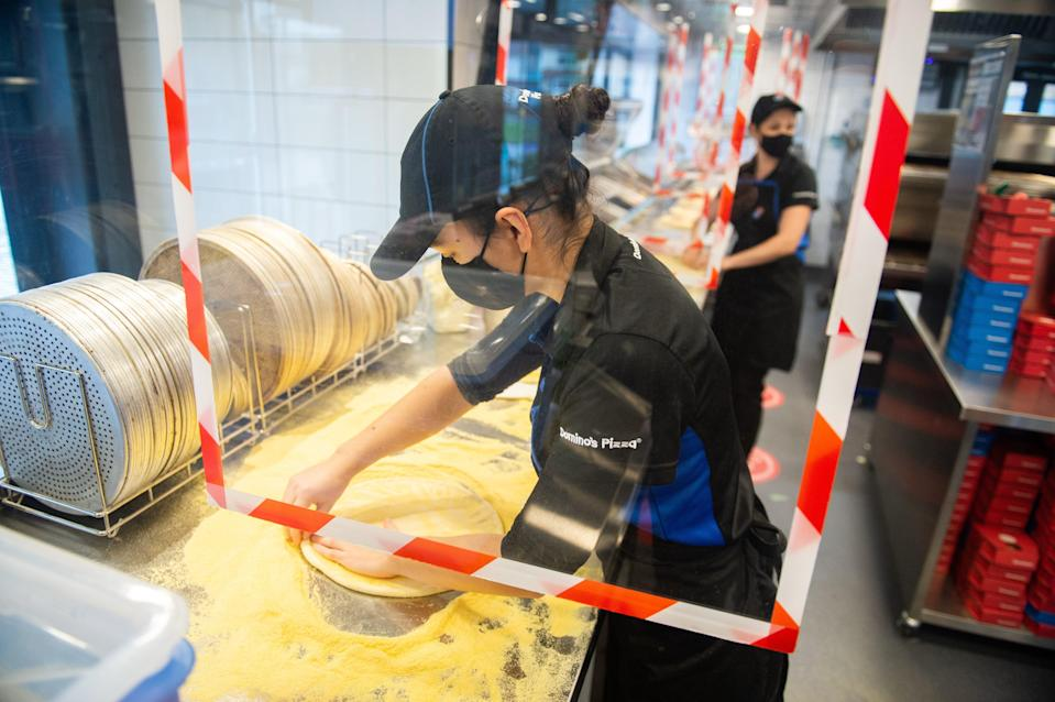 <p>Domino's Pizza saw sales surge by nearly a fifth in the first quarter as locked-down Britons ordered in</p> (PA)