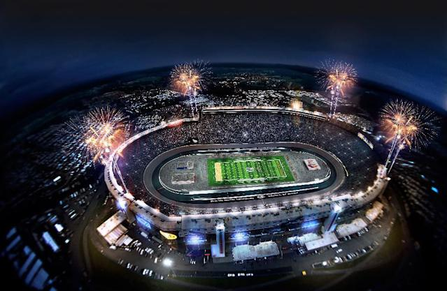 """This artist rendering provided by Bristol Motor Speedway, shows how the speedway is expected to look during a college football game in 2016. Tennessee and Virginia Tech will finally play a football game at Bristol Motor Speedway, in Bristol, Tenn., in what is being billed as the """"Battle of Bristol."""" (AP Photo/Bristol Motor Speedway)"""