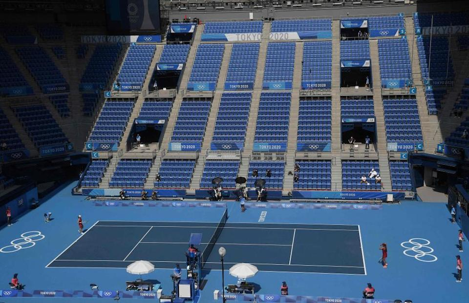 A general view shows empty stands during the match between Zheng Saisai and Naomi Osaka.