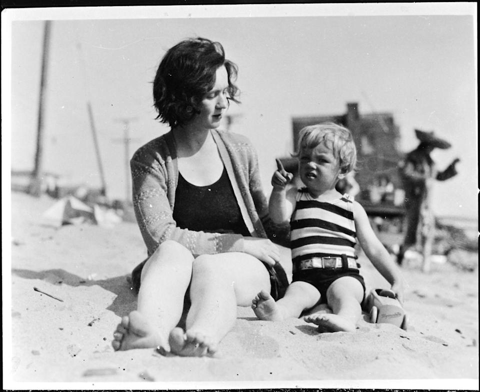 <p>Norma Jeane, a toddler at the time, and her mother, Gladys, lounge on a Southern California beach. </p>