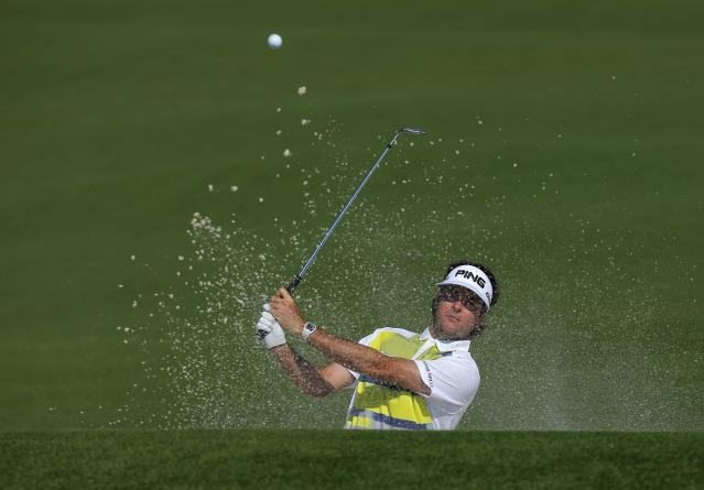 U.S. golfer Bubba Watson hits from the sand trap on the second hole during the second round of the Masters golf tournament at the Augusta National Golf Club in Augusta, Georgia April 11, 2014. REUTERS/Brian Snyder (UNITED STATES - Tags: SPORT GOLF)