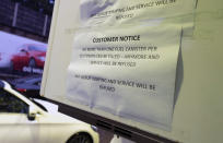 An information sign related to the current outbreak of fuel panic buying is seen at a petrol station in Manchester, England, Monday, Sept. 27, 2021. British Prime Minister Boris Johnson is said to be considering whether to call in the army to deliver fuel to petrol stations as pumps ran dry after days of panic buying. ( AP Photo/Jon Super)