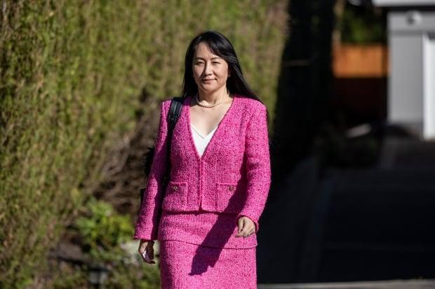 Huawei chief financial officer Meng Wanzhou leaves her home for B.C. Supreme Court in Vancouver, where her lawyers are arguing for a delay in extradition proceedings. (Ben Nelms/CBC - image credit)