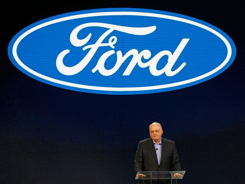 FILE PHOTO - Jim Hackett (L), President and CEO of Ford Motor Company, speaks at the Ford press preview at the North American International Auto Show in Detroit