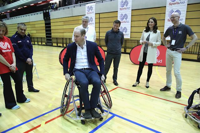 During a visit to an athletics charity, Prince William took a shot at wheelchair basketball — with Kate Middleton there to cheer him on.