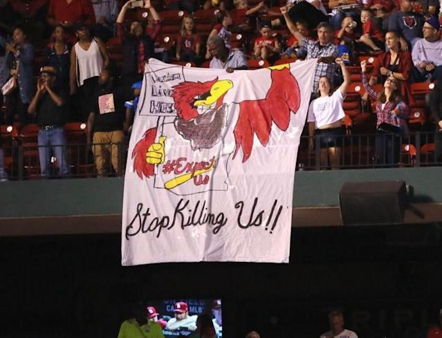 Protesters deliver message during Cardinals-Brewers game at Busch Stadium. (AP)