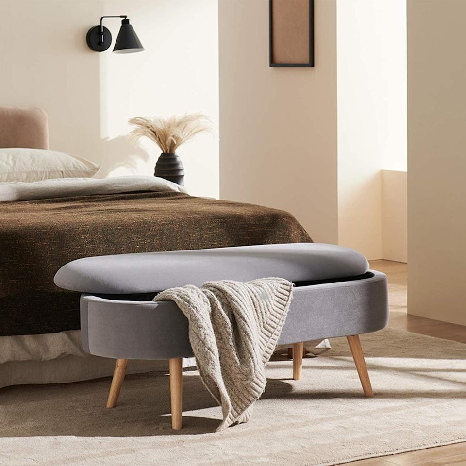<p>This <span>Harmati Velvet Storage Bench</span> ($150, originally $160) has an understated elegance, which is probably thanks to the clean lines, grey velvet fabric, and solid wood legs. It will fit right in your neutral-toned bedroom, while enhancing it with style and functionality.</p>