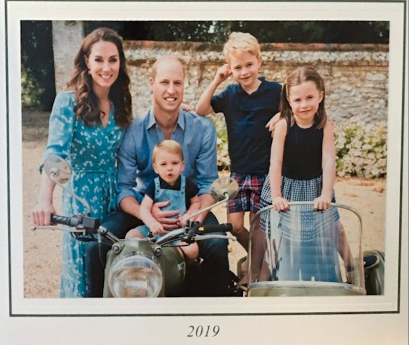 Prince William and Kate Middleton pose in a country setting on a motor bike with children George, Charlotte and Louis