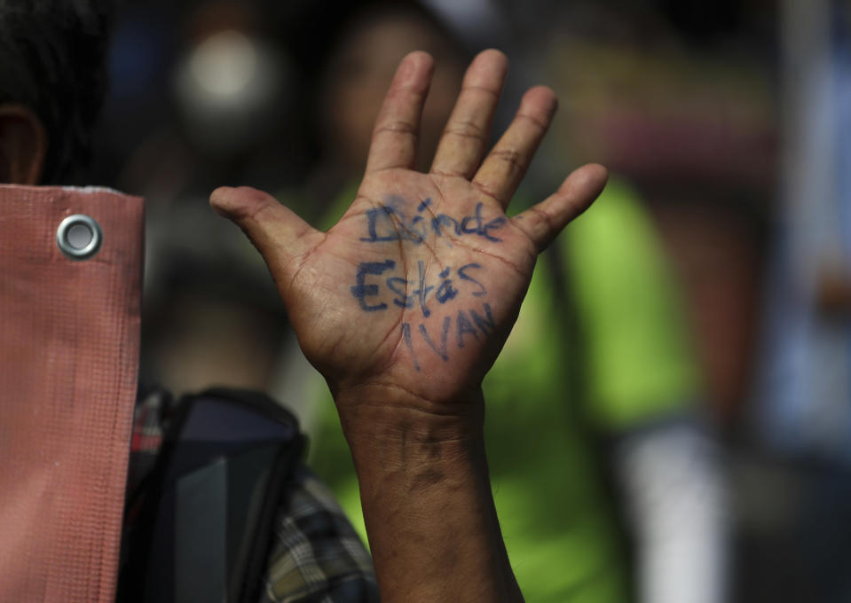 """A person's his hand reads in Spanish """"Where are you Ivan?"""" during a march in remembrance of those who have disappeared, on Mother's Day in Mexico City, Monday, May 10, 2021. (AP Photo/Fernando Llano)"""