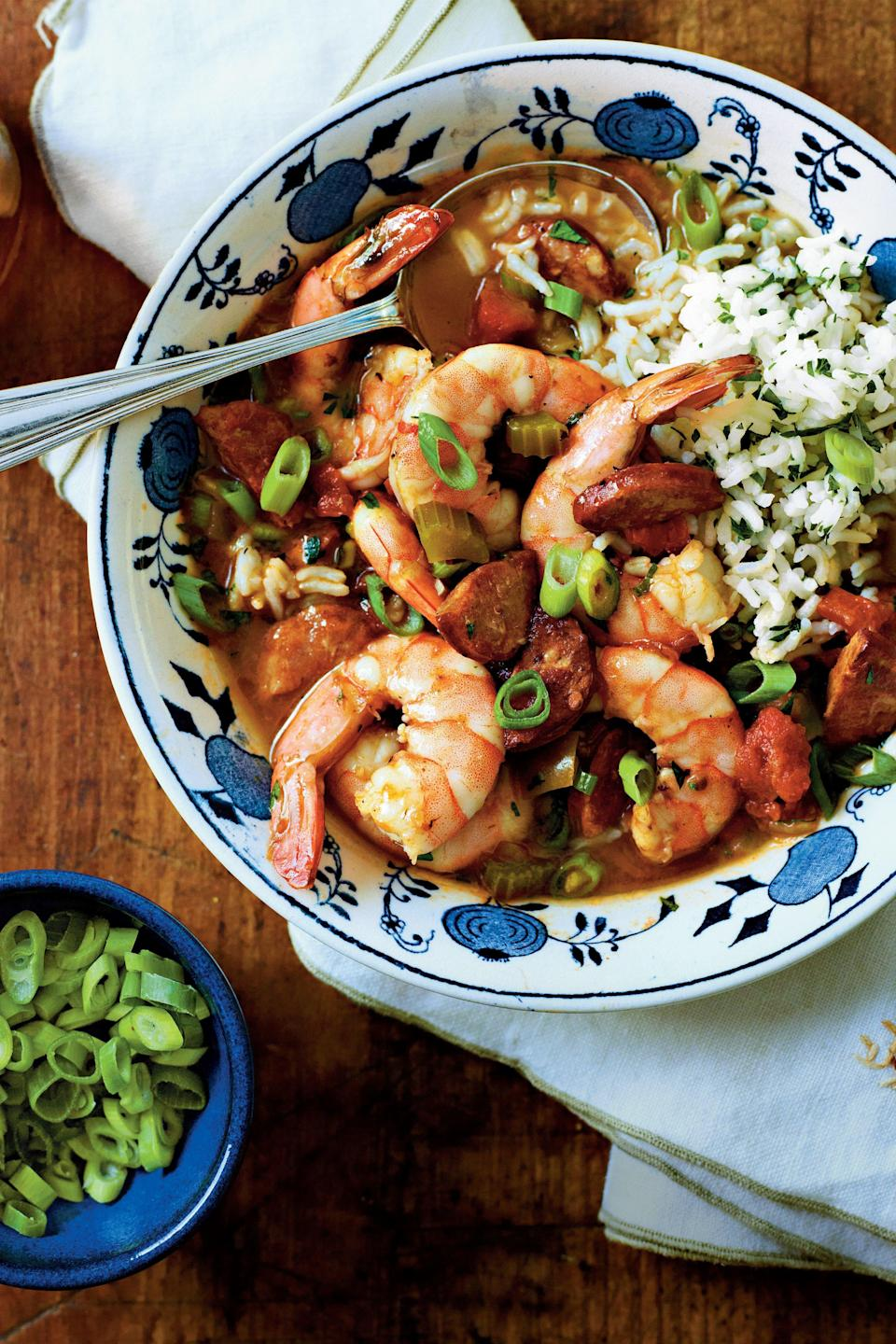 """<p><strong>Recipe:</strong> <a href=""""https://www.southernliving.com/recipes/shrimp-sausage-gumbo-recipe"""" rel=""""nofollow noopener"""" target=""""_blank"""" data-ylk=""""slk:Shrimp-and-Sausage Gumbo"""" class=""""link rapid-noclick-resp""""><strong>Shrimp-and-Sausage Gumbo</strong></a></p> <p>Enjoy a smoky and spicy classic that takes just a couple of minutes to prepare. When it's ready, serve over a bed of <a href=""""http://www.myrecipes.com/recipe/herbed-rice-50400000124739/"""" rel=""""nofollow noopener"""" target=""""_blank"""" data-ylk=""""slk:herbed rice"""" class=""""link rapid-noclick-resp"""">herbed rice</a>.</p>"""