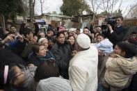 Pope Francis visits a shantytown on the outskirts of Rome February 8, 2015. REUTERS/Osservatore Romano