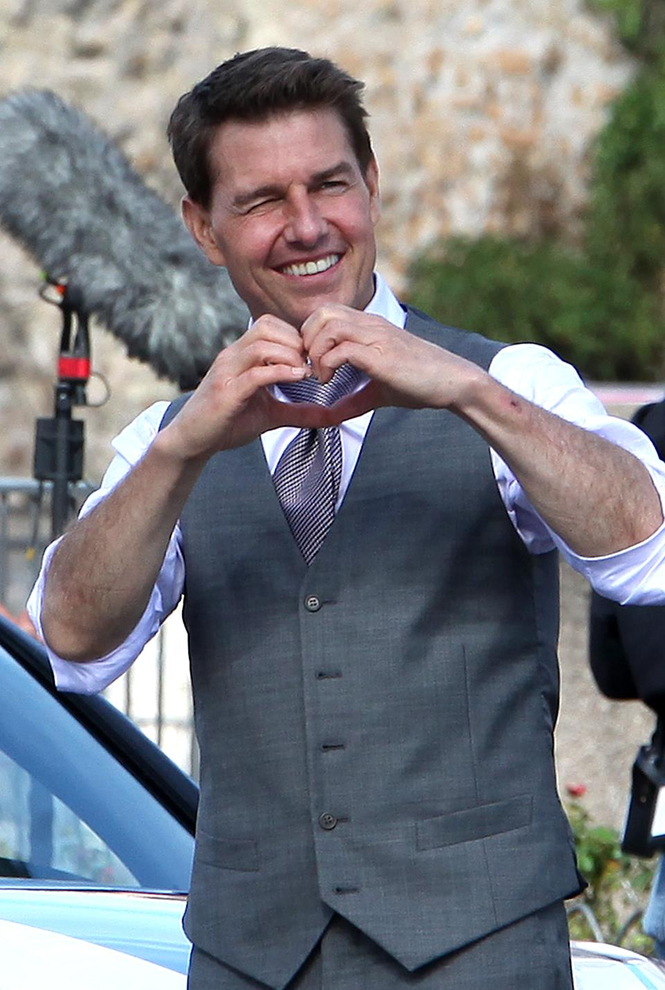 ROME ITALY - OCTOBER 12, 2020 Actor Tom Cruise makes a sign of a heart to fans during a break in the shooting of the film Mission Impossible 7- Lybra. The seventh installment in the Mission Impossible film series is to be released in 2021- PHOTOGRAPH BY Marco Ravagli / Barcroft Studios / Future Publishing (Photo credit should read Marco Ravagli/Barcroft Media via Getty Images)