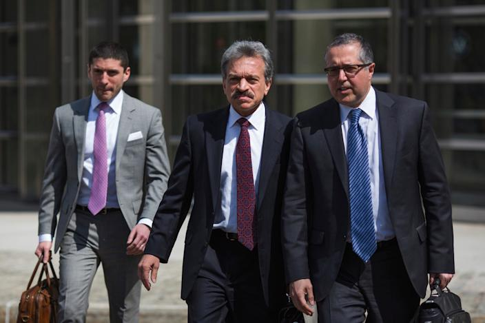Attorneys representing NXIVM leader Keith Raniere, Mark Agnifilo, right, and Paul DerOhannesian, II, center, leave following Raniere's arraignment in federal court on Friday, April 13, 2018, in New York.