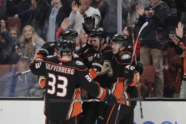 Anaheim Ducks' Jaycob Megna, second from right, celebrates his goal with Jakob Silfverberg, Korbinian Holzer and Rickard Rakell, from left, during the second period of an NHL hockey game against the St. Louis Blues on Wednesday, March 6, 2019, in Anaheim, Calif. (AP Photo/Jae C. Hong)