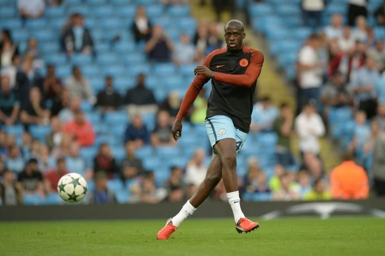 Manchester City's Ivorian midfielder and captain Yaya Toure warms up ahead of the UEFA Champions League second leg play-off football match between Manchester City and Steaua Bucharest