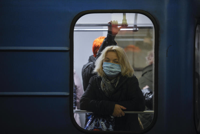 A woman wearing a protective mask as a precaution to the outbreak of Coronavirus rides on a subway in Kiev. The first case of coronavirus in Ukraine was recorded in Chernivtsi of a man who returned from Italy after a tourist trip. (Photo by Sergei Chuzavkov / SOPA Images/Sipa USA)