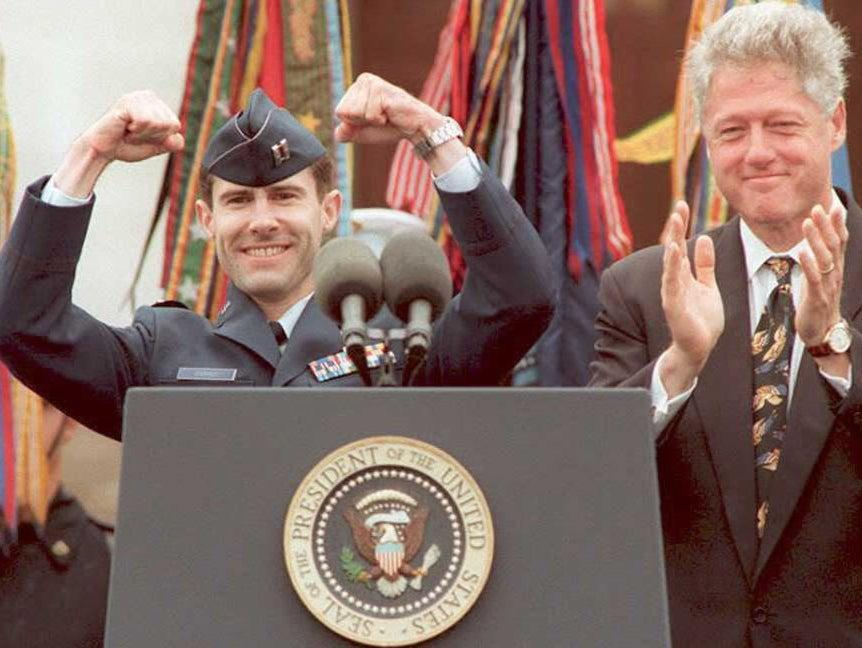 Scott O'Grady is welcomed back to the US by Bill Clinton after his F-16 was shot down over Bosnia. O'Grady avoided capture for six days before US marines rescued him (AFP via Getty Images)