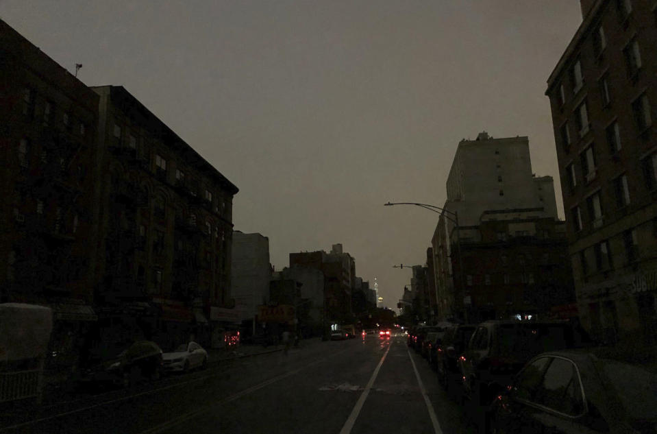 Buildings in Harlem sit dark during a power outage early, Friday, Aug. 7, 2020, in New York. A power outage cast darkness across dozens of blocks in New York City early Friday, as many people in the city were still without electricity in the aftermath of Tropical Storm Isaias. A statement from Con Edison says a transmission system problem caused three networks in Manhattan to lose their electric supply just after 5 a.m. (Tokuyuki Komiyama via AP)