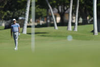 Stewart Cink watches his ball land on the 18th green during the second round of the Sony Open golf tournament Friday, Jan. 15, 2021, at Waialae Country Club in Honolulu. (AP Photo/Jamm Aquino)