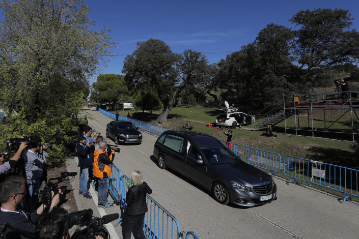A hearse carrying the coffin with the remains of Spanish dictator General Francisco Franco drives to Mingorrubio's cemetery, outskirts of Madrid, Thursday, Oct. 24, 2019. Forty-four years after his demise, the remains of Spanish dictator Gen. Spain has exhumed the remains of Spanish dictator Gen. Francisco Franco from his grandiose mausoleum outside Madrid so he can be reburied in a small family crypt north of the capital. (AP Photo/Manu Fernandez)