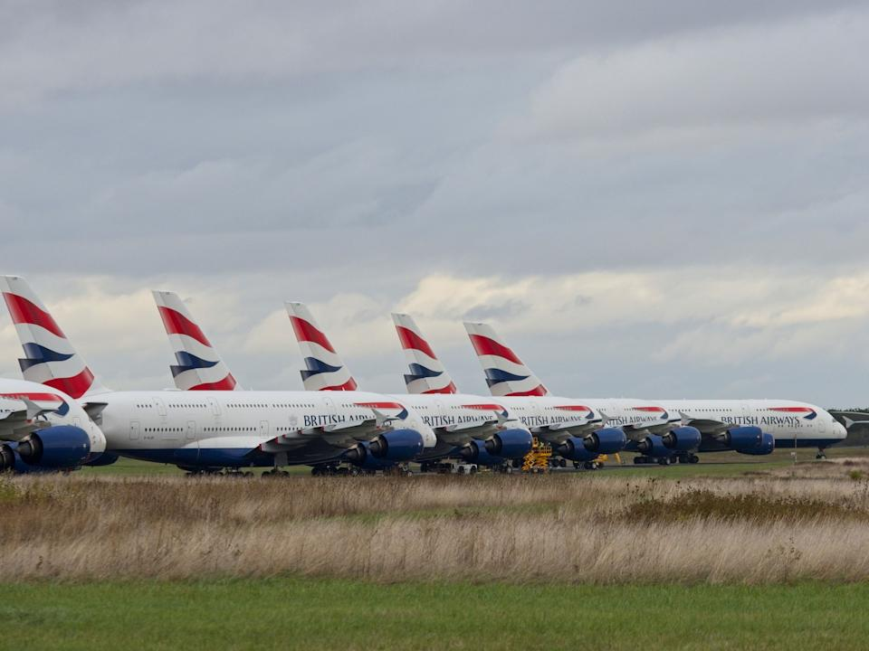 "British Airways Airbus A380 aircrafts are parked at the Chateauroux-Deols ""Marcel Dassault"" Airport (CHR) on October 29, 2020  in Deols, central France. - Many planes from several airlines are parked at Chateauroux-Deols airport until the end of the crisis caused by Covid-19, the new coronavirus. (Photo by GUILLAUME SOUVANT / AFP) (Photo by GUILLAUME SOUVANT/AFP via Getty Images)"
