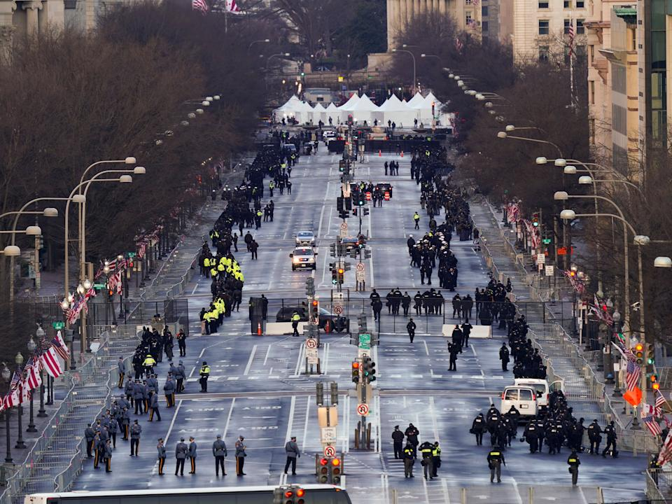 Security is set up along Pennsylvania Avenue before the 59th Presidential Inauguration. Security officials have assured that there will be extremely tight security around the entire capital region on Inauguration Day after pro-Trump rioters breached the Capitol on 6 January AP