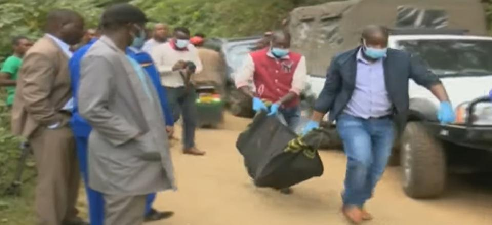 A body is retrieved by authorities in the search for the missing children. Source: Newsflash