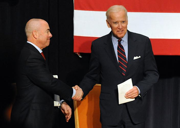 Alejandro Mayorkas and then-Vice President Joe Biden attend a naturalization ceremony at Martin Luther King, Jr. Center on November 14, 2013 in Atlanta, Georgia.  (Chris McKay/WireImage)