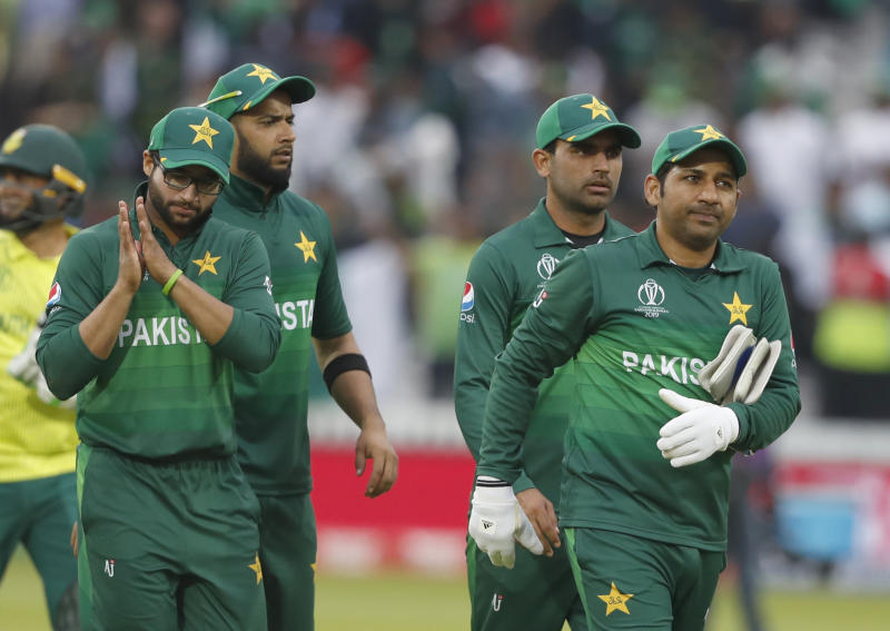 Pakistan's captain Sarfaraz Ahmed right leads the team from the field as they celebrate after they defeated South Africa by 49 runs in their Cricket World Cup match between Pakistan and South Africa at Lord's cricket ground in London, Sunday, June 23, 2019. (AP Photo/Alastair Grant)