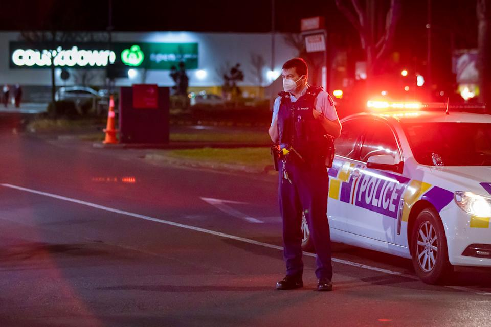 Police stand outside the site of a knife attack at the supermarket in Auckland, New Zealand. Source: AP