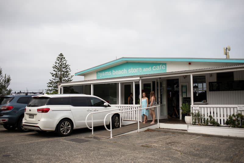 Customers stand at the entrance of the Hyams Beach Store and Cafe, in Hyams Beach