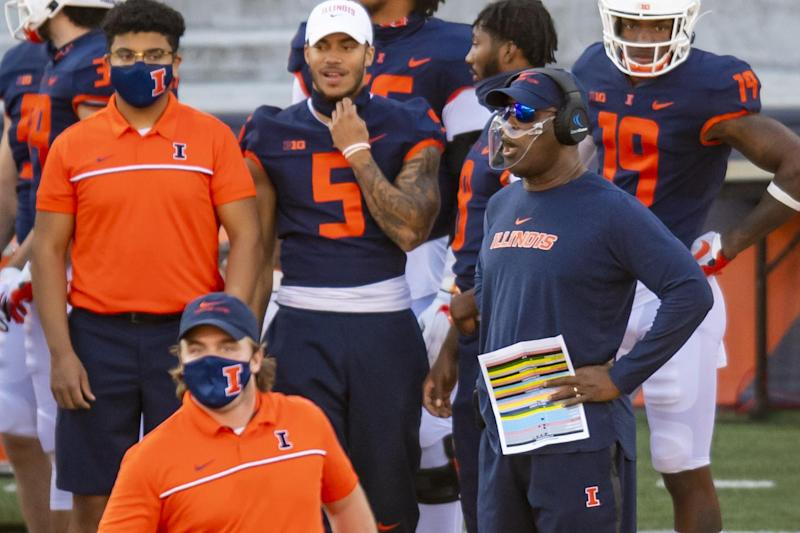 Illinois coach Lovie Smith (R) looks on from the sideline during the first half against Minnesota at Memorial Stadium in Champaign.