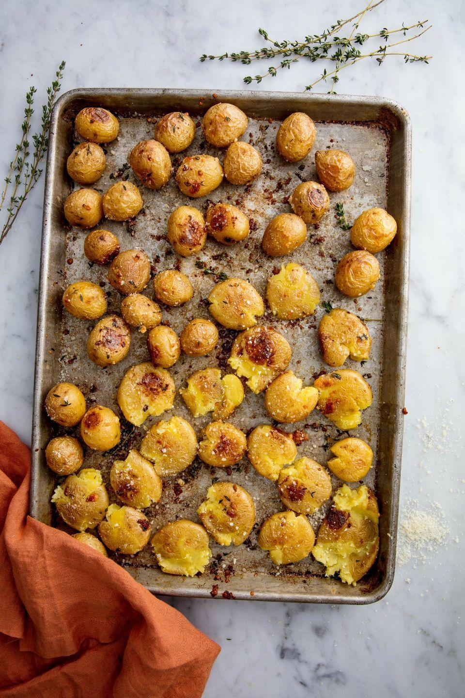 """<p>Garlic and parm go a long way to make these taters SO flavorful.</p><p>Get the recipe from <a href=""""https://www.delish.com/cooking/recipe-ideas/recipes/a49007/garlic-smashed-potatoes-recipe/"""" rel=""""nofollow noopener"""" target=""""_blank"""" data-ylk=""""slk:Delish"""" class=""""link rapid-noclick-resp"""">Delish</a>. </p>"""