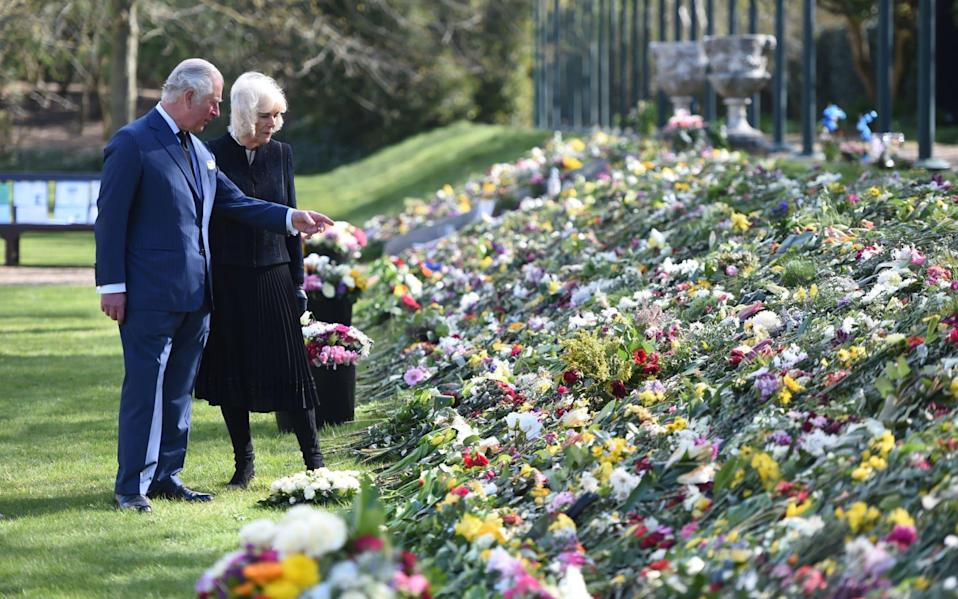 The Prince of Wales and the Duchess of Cornwall visit the gardens of Marlborough House, London, to view the flowers and messages left by members of the public outside Buckingham Palace following the death of the Duke of Edinburgh  - Jeremy Selwyn