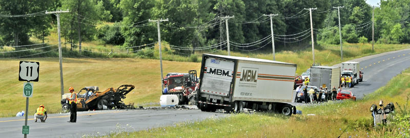 Emergency personnel investigate the scene of a fiery chain-reaction crash in a roadwork zone on Route 11 Thursday, July 19, 2012 in Antwerp, N.Y. Police say a tractor-trailer driven by James A. Mills Jr. of Myerstown, Pa., struck several vehicles that had slowed or stopped on the road. Five died in one SUV. They're identified as 42-year-old Laurie Dana of Lawrence; her daughters, 14-year-old Catelyn and 11-year-old Lauren; 69-year-old Janet Dana; and 14-year-old Shannon Planty. Police say another driver, 59-year-old Maryann Gregory of Dickinson Center, died at a hospital. (AP Photo/The Watertown Daily Times, Amanda Morrison) SYRACUSE OUT